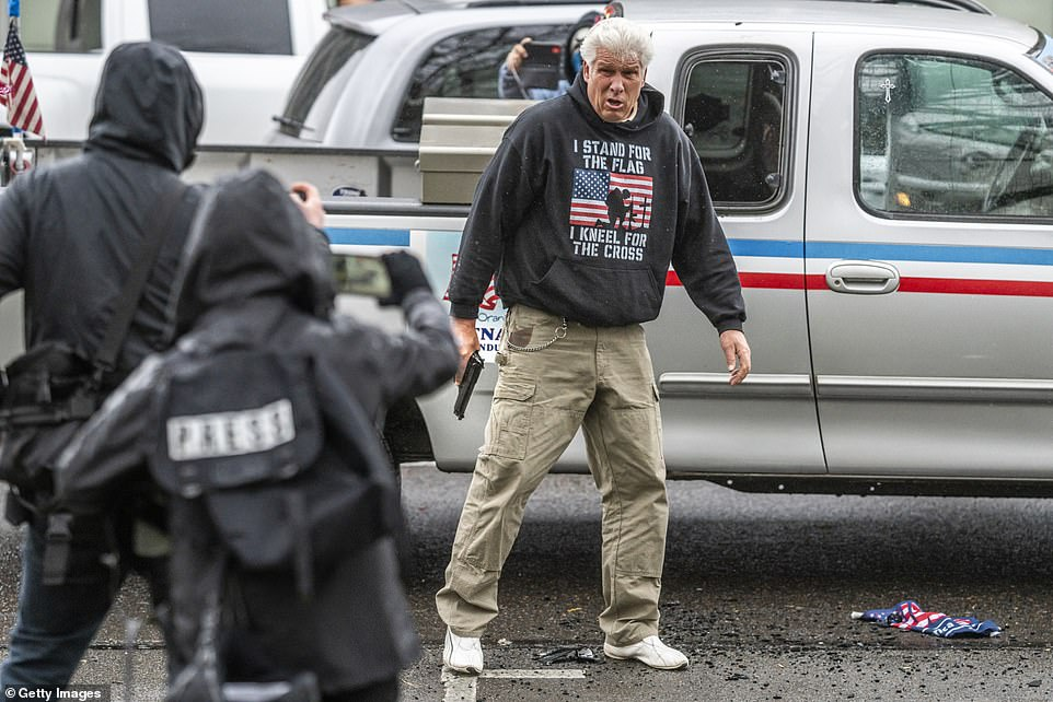 Moment Trump supporter pulls gun on rock-throwing ANTIFA rioters who smashed his truck's tail lights, sprayed paint on his windshield and then MACED him during Oregon Capitol rally